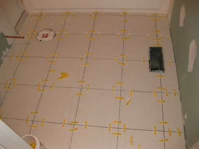 Leveling_floor_surfaces_bathroom_walls